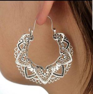Effie Ornate hoop style earrings